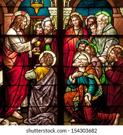 Stained glass window depicting Bible story of Last Supper with Jesus instituting the Holy Eucharist