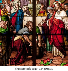 Stained glass window depicting Bible story of wedding feast of Cana, Jesus turning water into wine