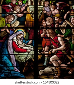 Stained glass window depicting biblical Christmas scene, the birth of Jesus Christ
