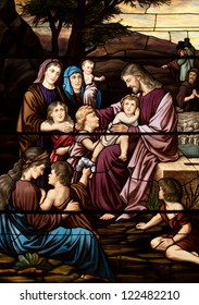 Stained glass window depicting gospel story of Jesus with the children