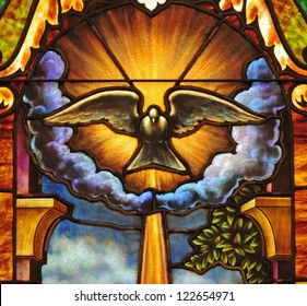 Stained glass window depicting the Holy Spirit in the form of a dove