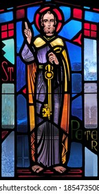 Stained glass window depicting St. Peter the Apostle holding a key