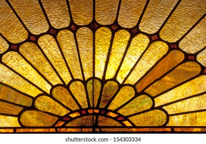 Stained glass window depicting sun burst or sun rays