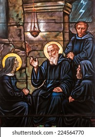 Stained glass window depicting twins St. Benedict and St. Scholastica, founders of Benedictine monasticism