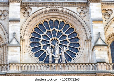 Stained glass window in facade of Notre dame cathedral.  North Rose window at Notre Dame cathedral dates from 1250 and is also 12.9 meters in diameter. Its main theme is the Old Testament