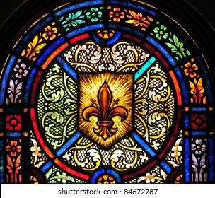 Stained glass window with fleur-de-lis symbol