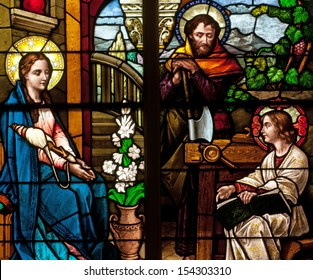 Stained glass window of Holy Family, Jesus, Mary and Joseph