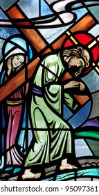 Stained glass window of Jesus Christ carrying the cross