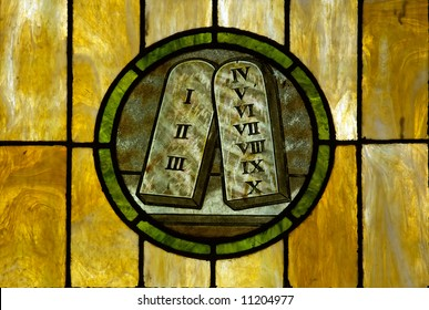 Stained glass window in a medieval church showing the 10 commandment tablets