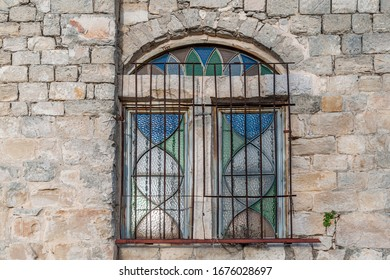 stained glass window in an old stone house