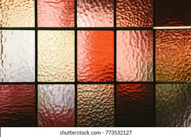 Stained glass window pane in red/orange hue