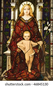 Stained glass window showing image of Madonna and Child. Vertical shot.