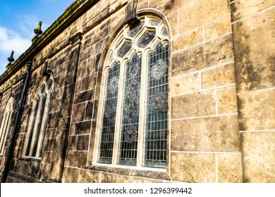 A stained glass window and wall of a church