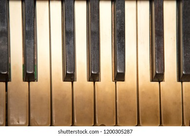 Stained keys of an old piano.