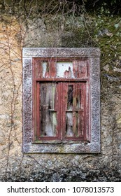 Stained old window on abandoned house