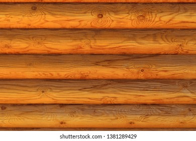Stained orange log wall of a rustic blockhouse with natural wood knots grain