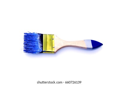 Stained paintbrush isolated on white macro shot.