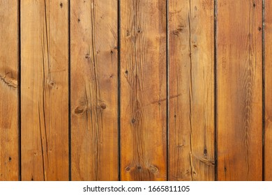 Stained wet deck wooden boards with water drops, brown planks texture