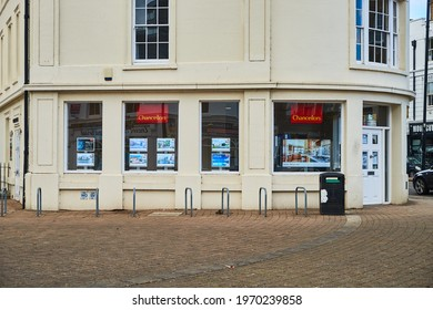 """"""" Staines upon Thames, Middlesex United Kingdom- 05 04 2021: The frontage and entrance to Chancellors estate agents located at Market Square in Staines upon Thames."""""""