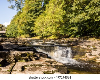 Stainforth Force waterfall in early Autumn, North Yorkshire, UK