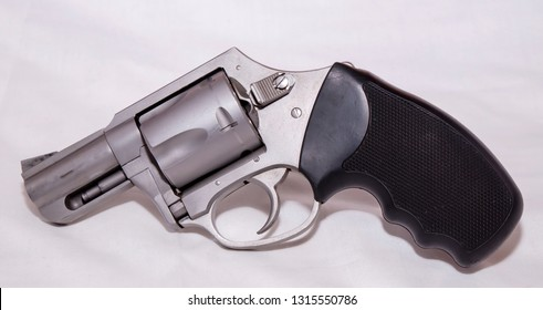 A stainless 357 magnum revolver shown on a white background