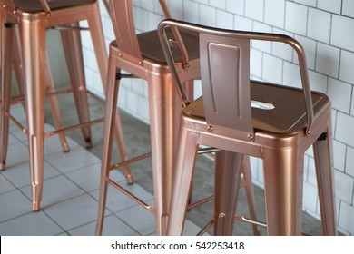 stainless bronze chair in cafe industrial mood