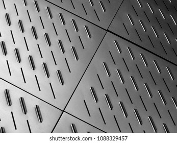 stainless corrugated surface, background or texture, monochrome photo