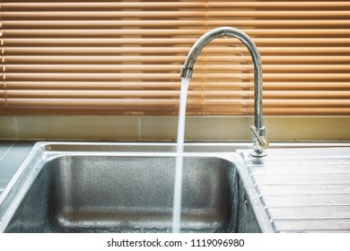 Stainless dirty sink in the kitchen room cloes up.