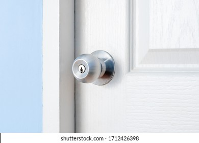 stainless door knob or handle on wooden white door