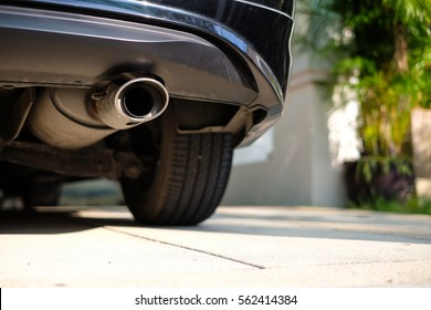 Stainless exhaust pipe at the bottom of car (selective background)