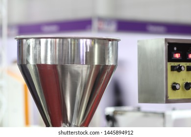 Stainless hopper is a part of machine for storage and suppy raw material  before processing