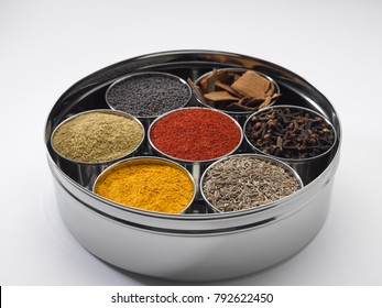 Stainless masala dabba on a white background