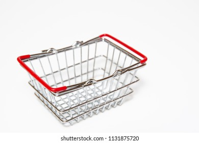 Stainless shopping basket close up on white background.