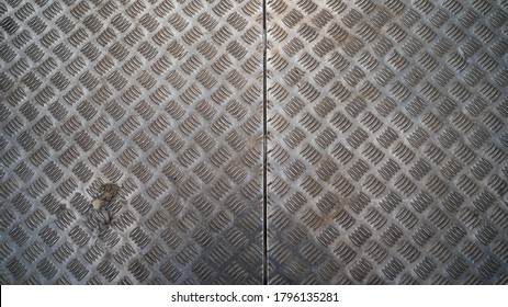 Stainless steal sheet wall, iron metal mild steel floor plate checker chequer, dirty grunge areal, top down