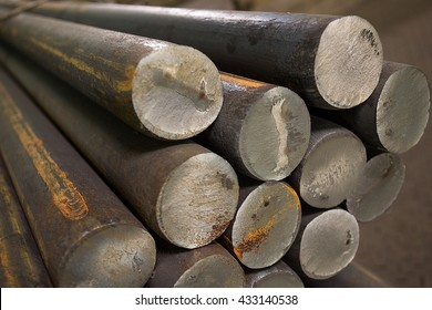 stainless steel bars deposited in stacks
