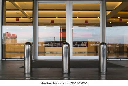Stainless steel bollard barriers at entrance door. Stainless steel pole prevent people for security