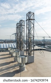 stainless steel chimneys and baffles on the roof of the building.