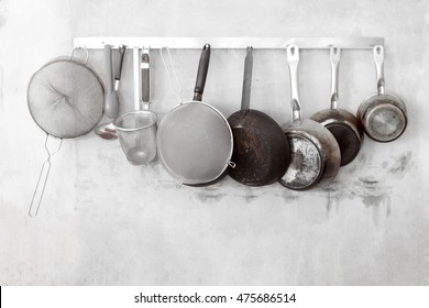 Stainless steel cookware , kitchenware set on concrete wall