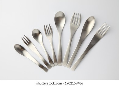 stainless steel cutlery sppons forks knife isolated on white background