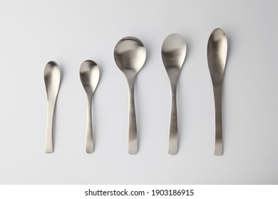 stainless steel cutlery sppons isolated on white background