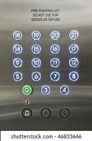 stainless steel dial of a passenger lift with glowing buttons