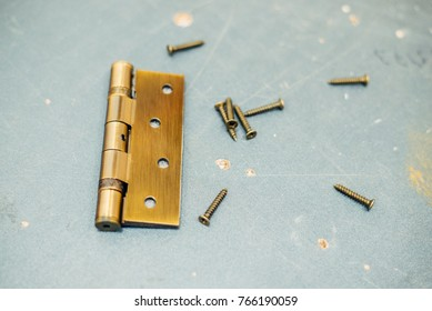 Stainless Steel Door Hinges with screw On Wooden Background