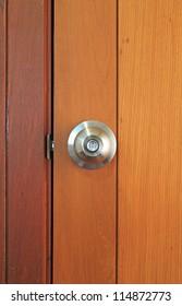 Stainless steel door knob on wooden door