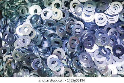 Stainless steel grower washers, Metal fasteners, Many washers for construction as an industrial style background , close-up