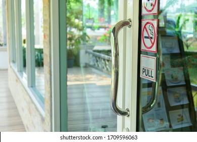 stainless steel handle on glass door