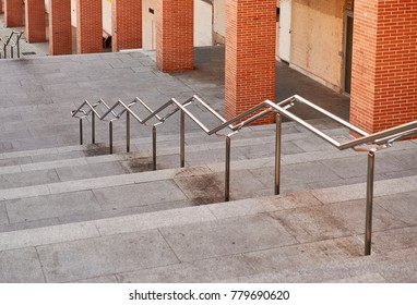 stainless steel handrail on stone staircase