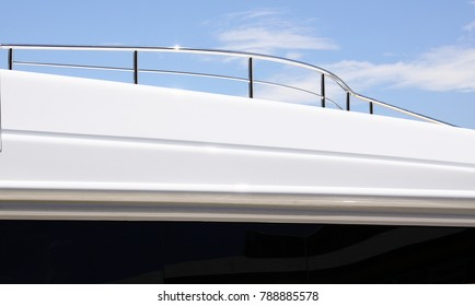 Stainless steel handrails on top of a super yacht shining in a clear day