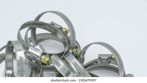 Stainless Steel hose pipe clamps on white background.