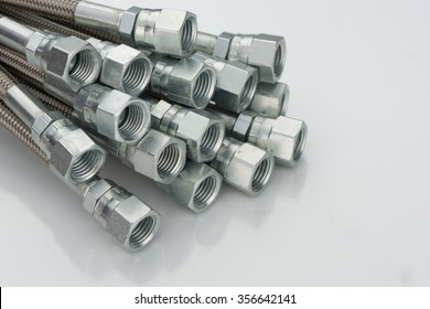 Stainless Steel Hydraulic Hoses on White