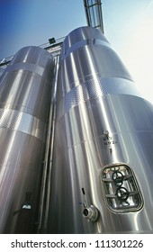 Stainless steel industrial silo with catwalk and faucet used in modern wine making